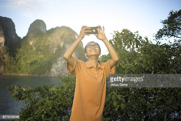 vietnamese plays with your iphone - laughing jesus images stock pictures, royalty-free photos & images