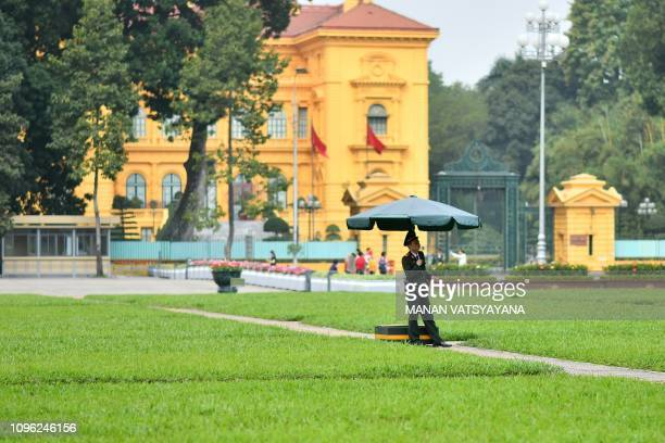 A Vietnamese police personnel stands guard outside the Presidential palace in Hanoi on February 9 2019 US President Donald Trump announced on...