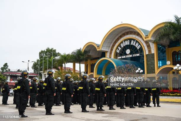 Vietnamese police stand in a formation outside the Dong Dang railway station where North Korean leader Kim Jong Un is expected to arrive by train...