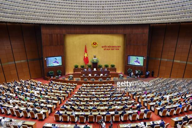 Vietnamese political leaders and members of parliament attend the National Assembly's autumn session at the Parliament house in Hanoi on October 21...