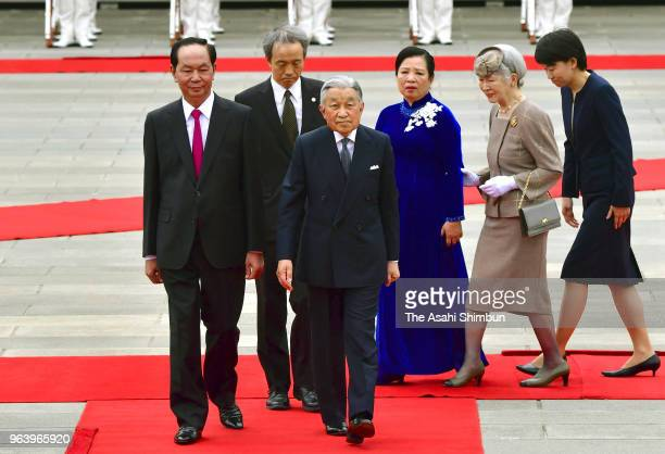 Vietnamese President Tran Dai Quang and his wife Nguyen Thi Hien attend the welcome ceremony with Emperor Akihito and Empress Michiko at the Imperial...