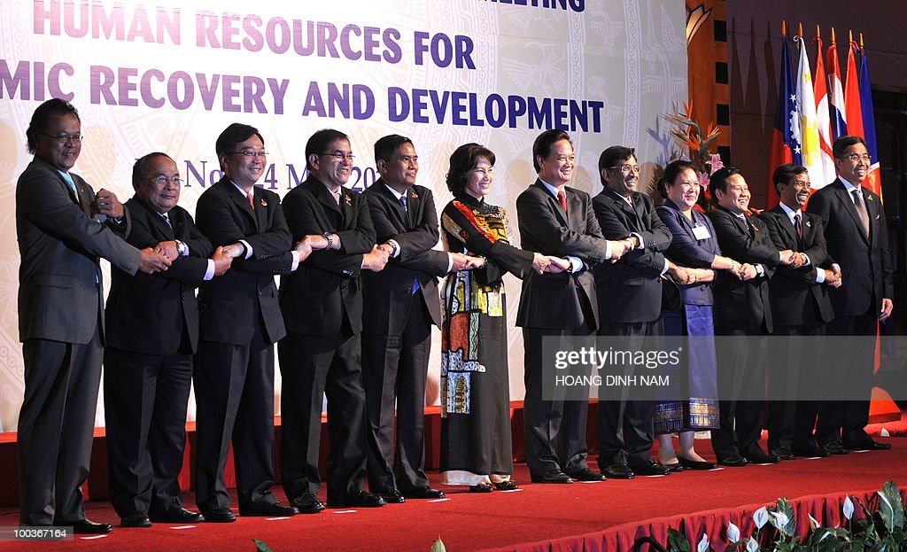 Vietnamese prime minister Nguyen Tan Dung (6R) and ASEAN deputy secretary general Dato Misran Karmain (L) links arms with delegate ministers and officials from the Association of Southeast Asian Nations (ASEAN) during the opening of their two-day meeting in Hanoi on May 24, 2010. The ministers and officials are (L-R): Thailand's Minister Office of the Permanent Secretary for the Ministry of Labour Phaithoon Kaeothong, Singapore's Minister of Manpower Gan Kim Yong, Philippines' Minister of Labour Marianito Roque, Myanmar's Minister of Labour U Aung Kyi, Vietnam's Minister of Labour Nguyen Thi Kim Ngan, Malaysia's Minister of Human Resources Datuk Subramanian, Laos' Minister of Labour and Social Welfare Onechanh Thammavong, Indonesia's Minister of Manpower and Transmigration Muhaimin Iskandar, Cambodia's Minister of Labour and Vocational training Vong Sauth and Brunei's Minister of Home Affairs Pehin Dato Adanan Yusof. AFP PHOTO/HOANG DINH Nam