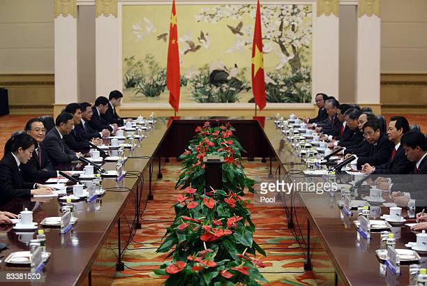 Vietnamese Prime Minister Nguyen Tan Dung and Chinese President Hu Jintao lead their delegations during a meeting at the Great Hall of the People on...
