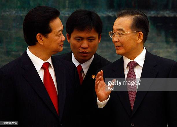 Vietnamese Prime Minister Nguyen Tan Dung and Chinese President Hu Jintao speak through a translator during a signing ceremony at the Great Hall of...