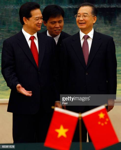 Vietnamese Prime Minister Nguyen Tan Dung and Chinese President Hu Jintao smile as they speak through a translator during a signing ceremony at the...