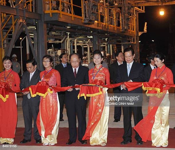 Vietnamese Prime Minister Nguyen Tan Dung and other Vietnamese officials cut a ribbon during the inauguration ceremony of the Dung Quat oil refinery...