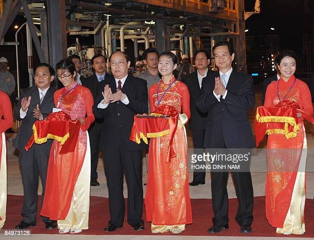 Vietnamese Prime Minister Nguyen Tan Dung applauds after cutting the ribbon during the inauguration ceremony of the Dung Quat oil refinery - the...