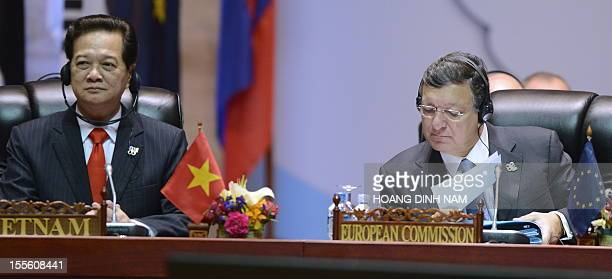 Vietnamese Prime Minister Nguyen Tan Dung sits next to President of the European Commission Jose Manuel Barroso as they attend a plenery session of...