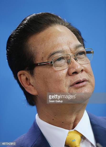 Vietnamese Prime Minister Nguyen Tan Dung speaks to the media with German Chancellor Angela Merkel following talks at the Chancellery on October 15...
