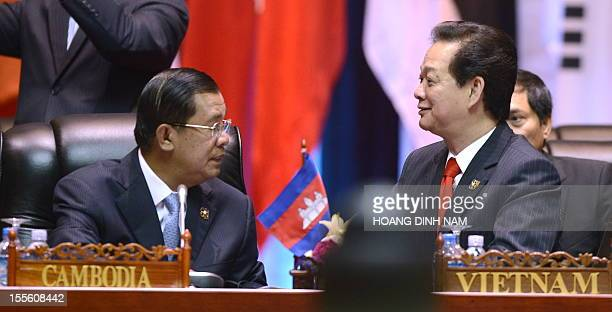 Vietnamese Prime Minister Nguyen Tan Dung talks with his Cambodian counterpart Hun Sen as they attend a plenery session of the 9th summit AsiaEurope...