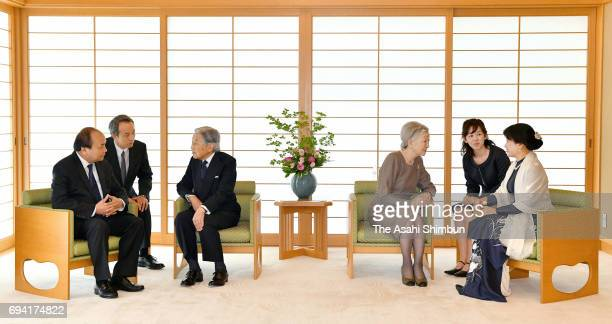 Vietnamese Prime Minister Nguyen Xuan Phuc and his wife Tran Nguyet Thu talk with Emperor Akihito and Empress Michiko during their meeting at the...
