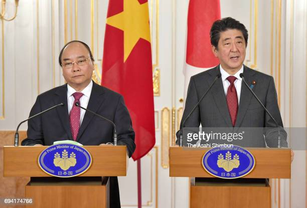 Vietnamese Prime Minister Nguyen Xuan Phuc and Japanese Prime Minister Shinzo Abe attend a joint press conference following their meeting at the...