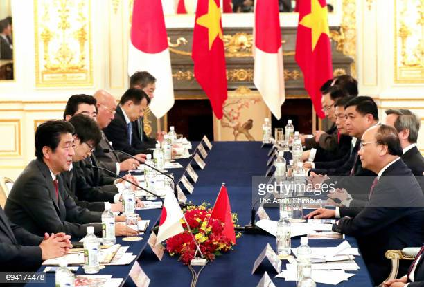 Vietnamese Prime Minister Nguyen Xuan Phuc and Prime Minister Shinzo Abe talk during their meeting at the Akasaka State Guest House on June 6 2017 in...