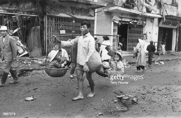 Vietnamese refugees returning to the city of Hue after it was recaptured by American troops with their South Vietnamese allies