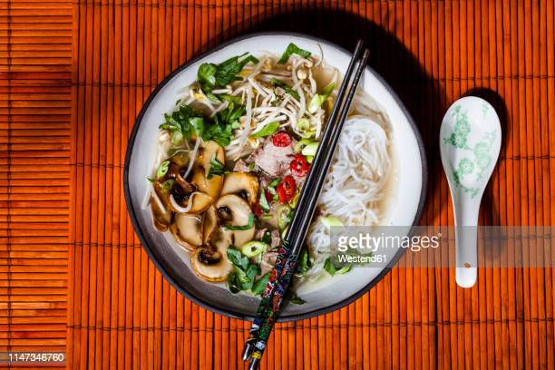 vietnamese rice noodle soup with mushrooms and beef - asian food stock pictures, royalty-free photos & images