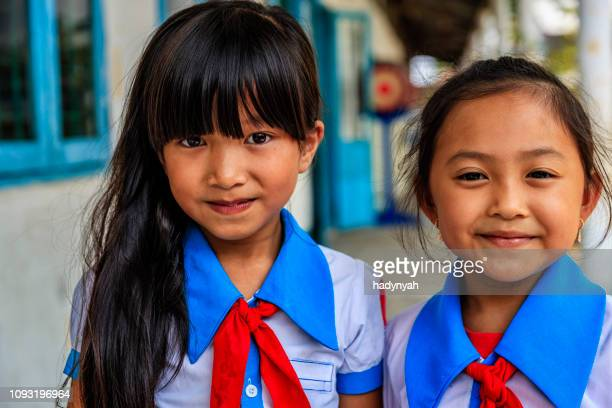 vietnamese schoolgirls on a schoolyard, south vietnam - traditionally vietnamese stock pictures, royalty-free photos & images