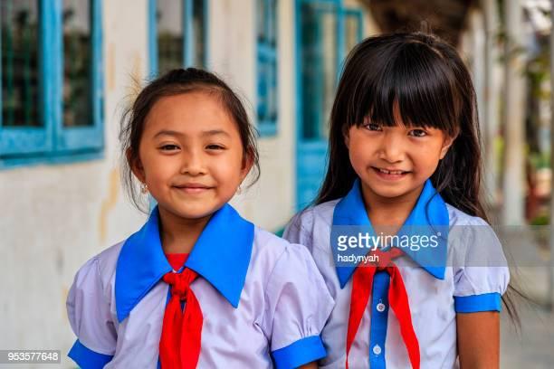 vietnamese schoolgirls on a schoolyard, south vietnam - vietnamese culture stock pictures, royalty-free photos & images
