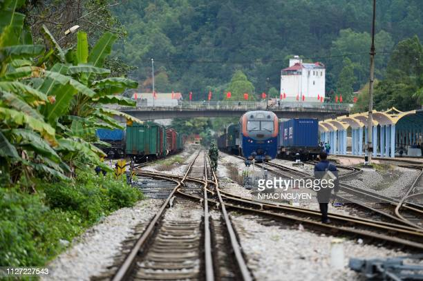 A Vietnamese soldier and a man inspect the track near the Dong Dang railway station where North Korean leader Kim Jong Un is expected to arrive by...