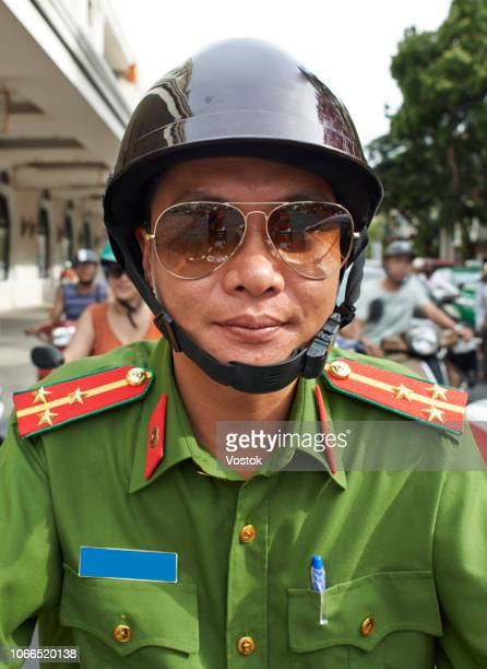 vietnamese soldier on the moped - 肩章 ストックフォトと画像