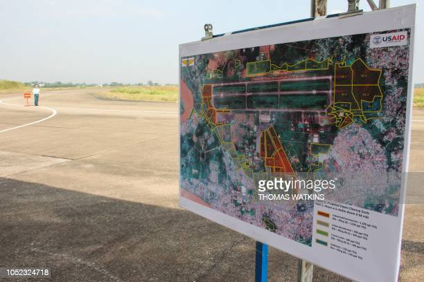 A Vietnamese soldier stands guard near a map of the Bien Hoa air base on the outskirts of Ho Chi Minh City as US Defence Secretary Jim Mattis visits...
