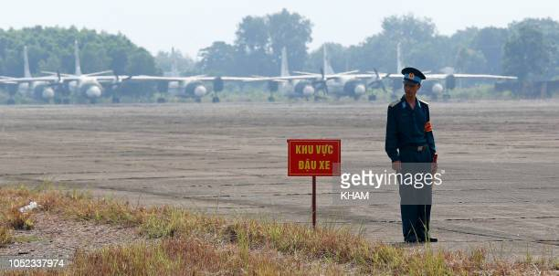 A Vietnamese soldier stands next to a hazardous warning sign by a runway at Bien Hoa air base on the outskirts of Ho Chi Minh City as US Defence...