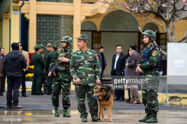 Vietnamese soldiers stand guard near an entrace of the Dong Dang railway station where North Korean leader Kim Jong Un is expected to arrive by train...