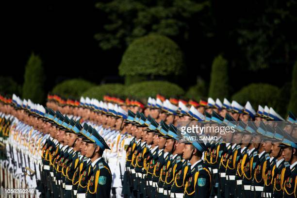 Vietnamese soldiers stand in a formation as they wait for a ceremony to welcome French Prime Minister Edouard Philippe at the Presidential Palace in...