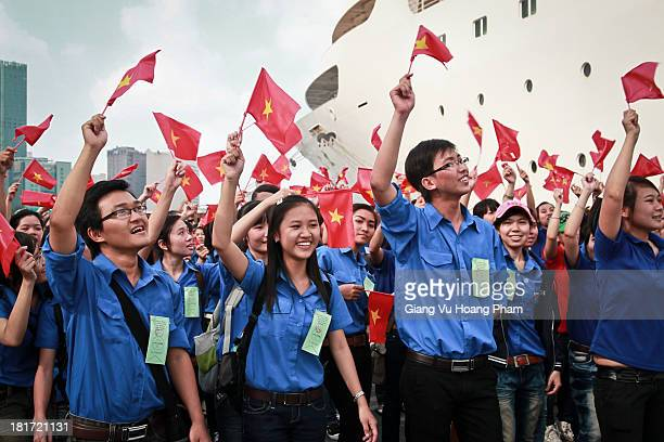 Vietnamese students wave flags at the welcoming ceremony for the Ship for South East Asian Youth, Ho Chi Minh City, December 2011