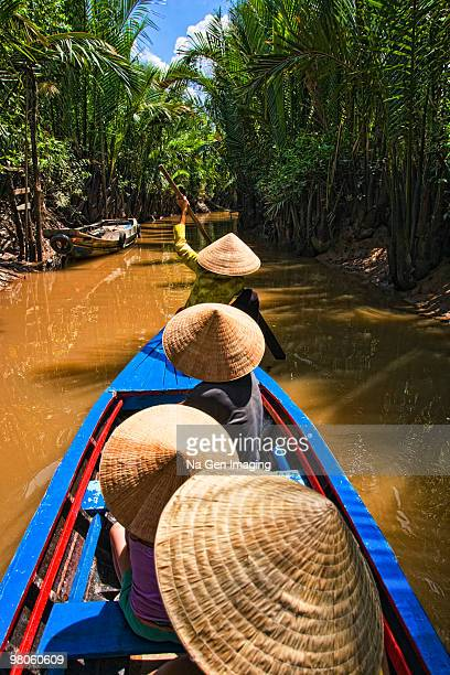 Vietnamese traveling by boat in the Mekong Delta
