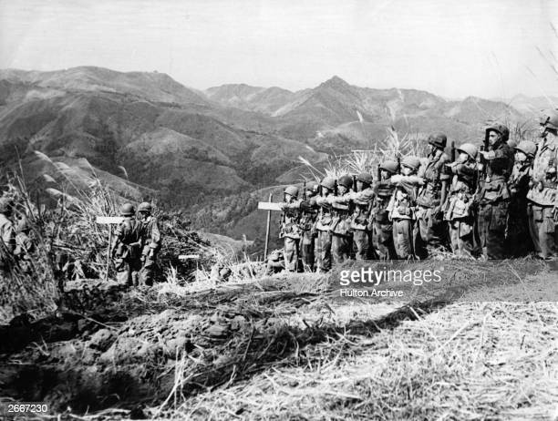 Vietnamese troops who parachuted into the area north of Dien Bien Phu await French officer instructions.