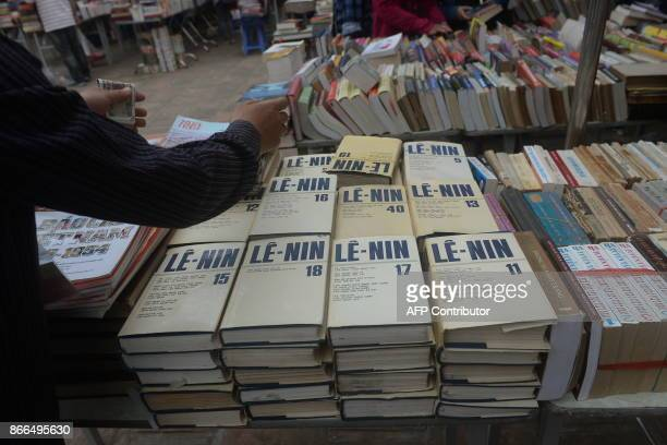 Vietnamese versions of Vladimir Lenin's works Russian communist leader are seen displayed for sale at a local used books fair in Hanoi on October 26...