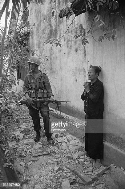 Vietnamese villagers watch as American planes bomb village of Quinhon attacking Viet Cong sniper positions Villagers were evacuated and led across...