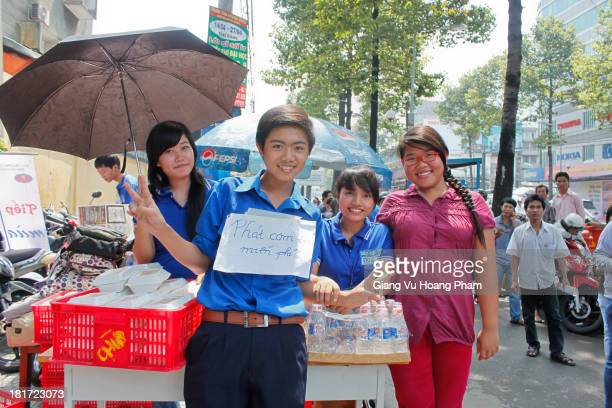 CONTENT] Vietnamese volunteer students smile when they are preparing free lunch for students who have entrance exam to university July 2011 Ho Chi...
