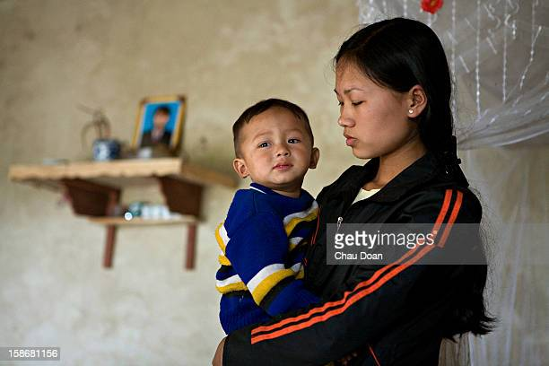 Vietnamese woman after visiting the grave of her husband who died of AIDS a few months ago after infecting her with HIV But their twoyearold son has...