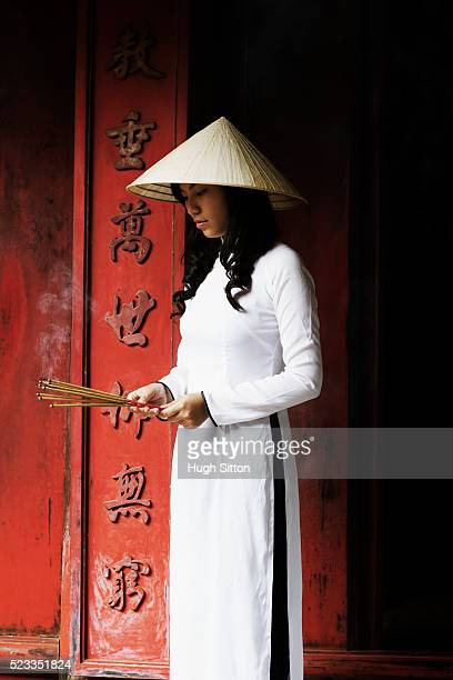 vietnamese woman at the temple of literature - hugh sitton stock pictures, royalty-free photos & images