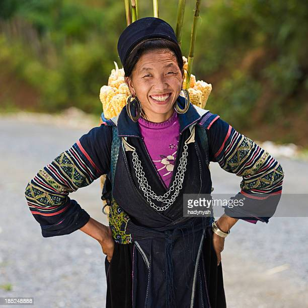 Vietnamese woman carrying corn near Sapa town
