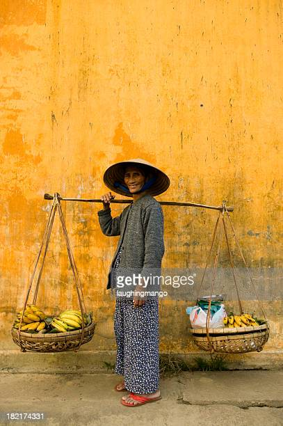 vietnamese woman copy space yellow wall