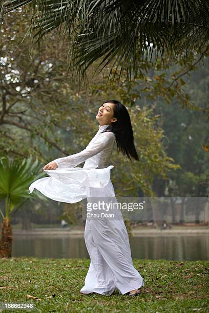 Vietnamese woman dances with her Vietnamese traditional costume called Ao Dai MODEL RELEASED