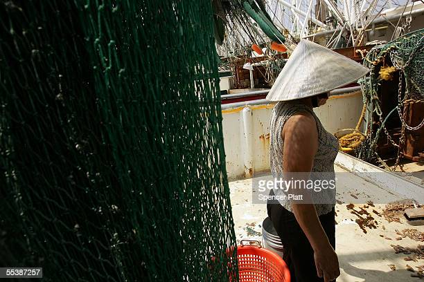 Vietnamese woman employed in the shrimp fishing trade stands on a boat after her home was destroyed by Hurricane Katrina September 12 2005 in Biloxi...