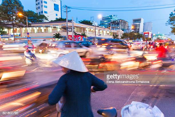 Vietnamese woman is trying to cross the road