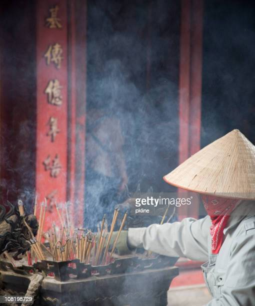 Vietnamese Woman Lighting Incense
