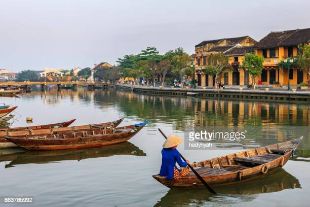 vietnamese woman paddling in old town in hoi an city, vietnam - vietnam stock pictures, royalty-free photos & images
