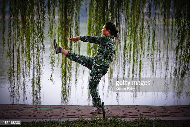 Vietnamese woman performs early morning calisthenics at Hoan Kiem Lake, central Hanoi, a daily routine carried out alongside many thousands of other...
