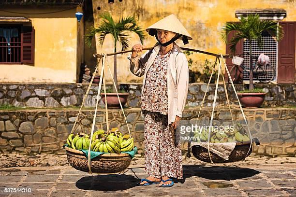 Vietnamese woman selling bananas in Hoi An