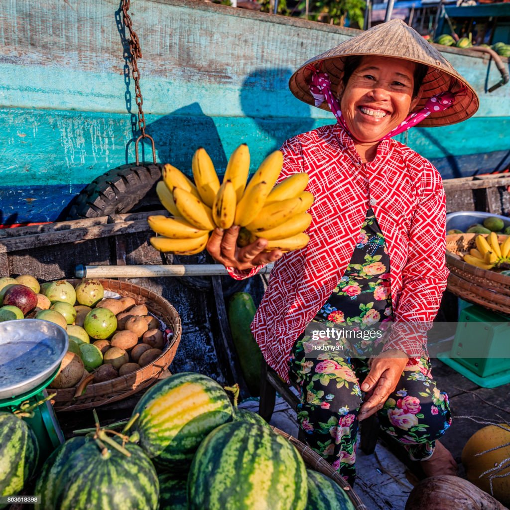 Vietnamese woman selling bananas on floating market, Mekong River Delta, Vietnam : Stock Photo