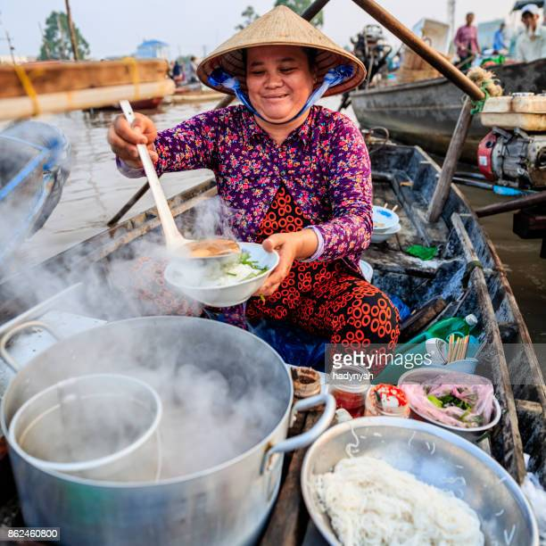 vietnamese woman selling famous noodle soup, floating market, mekong river delta, vietnam - floating market stock pictures, royalty-free photos & images