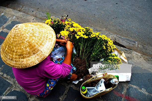 A Vietnamese woman selling flower at Hoi An