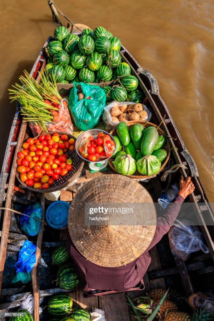 Vietnamese woman selling fruits on floating market, Mekong River Delta, Vietnam : Stock Photo