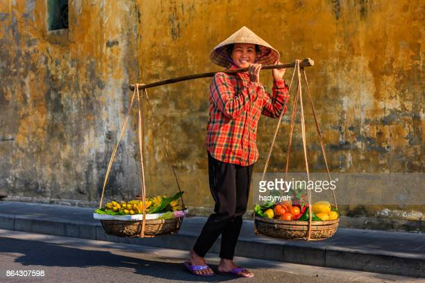 vietnamese woman selling tropical fruits, old town in hoi an city, vietnam - vietnam stock pictures, royalty-free photos & images