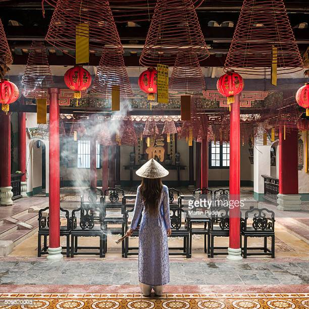 Vietnamese woman standing inside temple